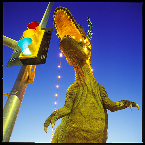 Dinosaur by stoplight at sunset in Tucson.