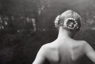 Sally Mann photo of young woman facing away