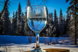 A glass of water on a clear sunshiny day