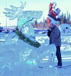 Ice sculptures next to Santa Clause House - Lady taking picture.