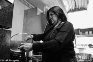 The woman at the Mexican restaurant. Making refried beans.